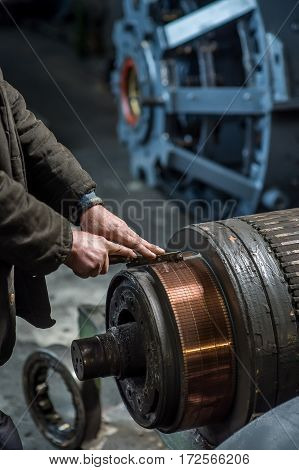 Working hand man with the iron factory