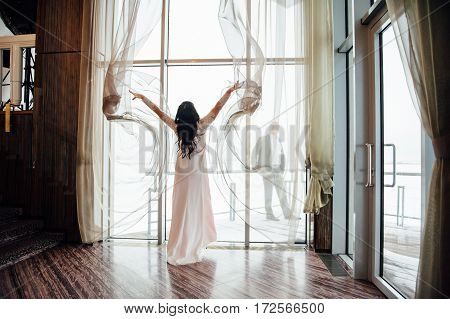 Beautiful Woman Opens The Curtains In The House