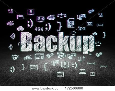 Software concept: Glowing text Backup,  Hand Drawn Programming Icons in grunge dark room with Dirty Floor, black background
