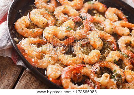 Fried Shrimp In Garlic Sauce With Parmesan And Herbs Closeup. Horizontal