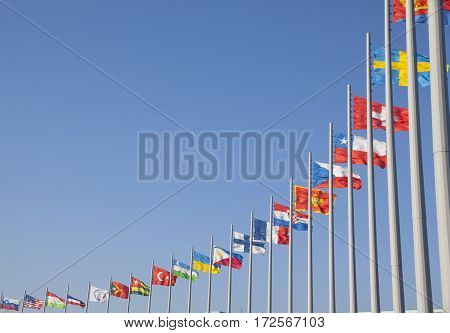 Flags of different countries on the flagpole