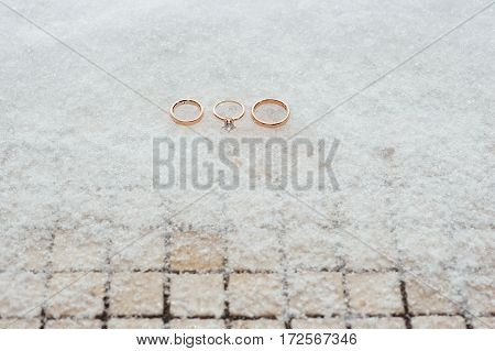 Wedding And Engagement Rings On The Snow