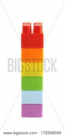 Single stack of the plastic construction toy bricks isolated over the white background