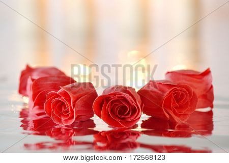 Red soap roses with reflection positioned in a circle