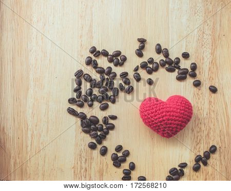 coffee bean and heart symbol on wood background