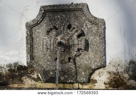Horizontal image of antique source of mineral water.