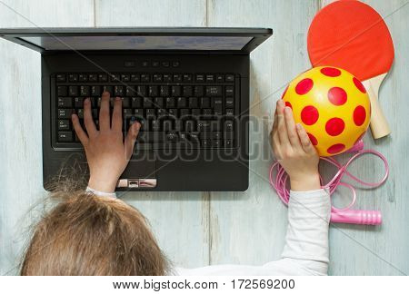 Internet addiction and computers concept with kid and laptop
