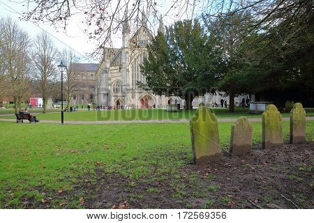 WINCHESTER, UK - FEBRUARY 4, 2017: Exterior view of the Cathedral with tombs in the foreground