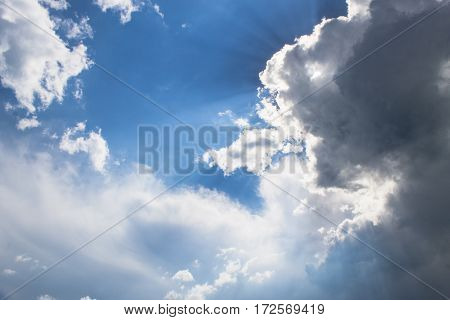 Stunning blue and white cloudscape background with sunlight