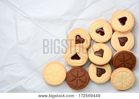 Heart shape chocolate cookies on white paper