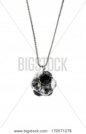 Crystal pendant on a chain isolated over white