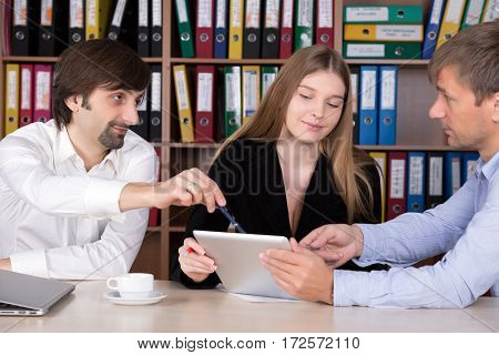 Group of young Business People conducting Discussion using Tablet Computer