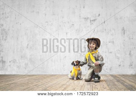 Smiling child with terrier indoors