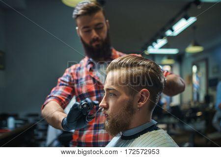 Customer and hairdresser in barber shop