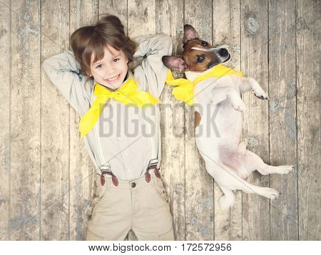Smiling boy with dog on a floor
