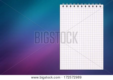 Blank notebook on a colorful glass background with copy space top view