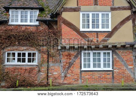 WINCHESTER, UK - FEBRUARY 5, 2017:  Exterior facade of a half timbered house on Kingsgate Street with colorful bricks