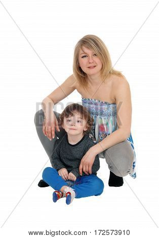 A portrait image of a young woman with her three year old son isolated for white background.