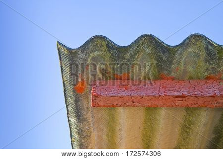 Wooden shack with a dangerous asbestos roof