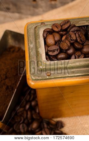 Close up of coffee beans in a coffee mill