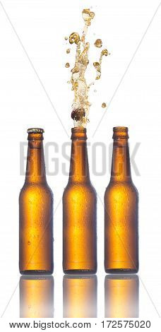 Set of beer bottles with popping corks . Isolated on white background