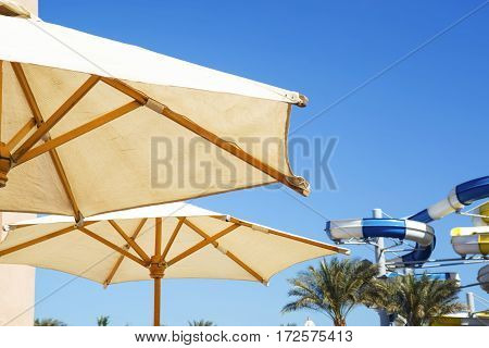 Sunshades in the blue sky in Hurghada background
