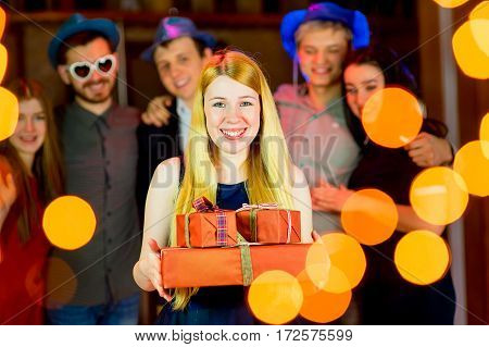 Young peoples birthday party. Gathering a lot of gifts in the nightclub
