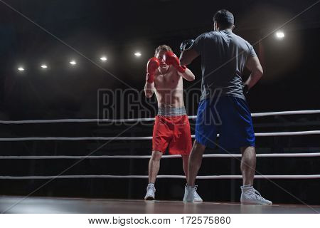 Fighting men in a boxing ring