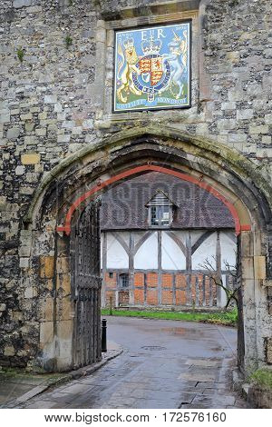 WINCHESTER, UK - FEBRUARY 5, 2017:  The Priory Gate with Coat of Arms at the entrance of the old city