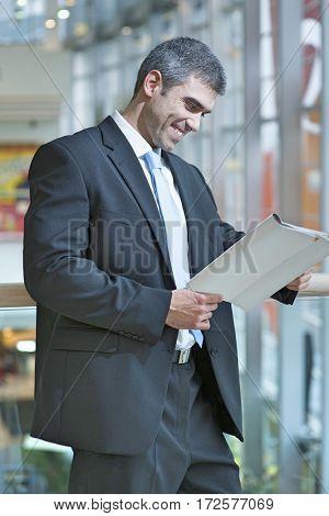 Businessman reading document