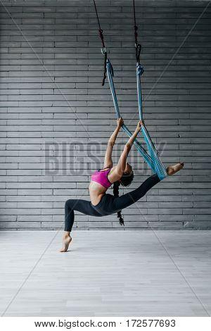 Young beautiful fitness woman posing in studio