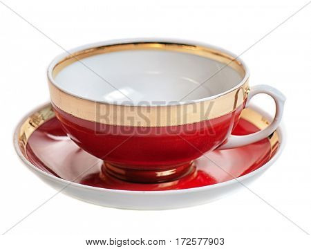 red with gold fillet teacup and saucer isolated on white background