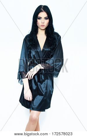 Sexy Girl Posing In Black Silk Robe Isolated On White