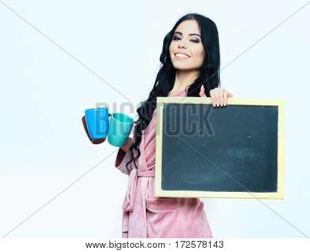 Smiling Girl In Pink Velour Homesuit With Cup And Board