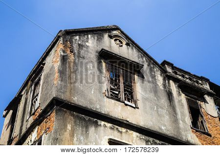 Close up of an old damaged French architectural house in Hanoi capital, Vietnam