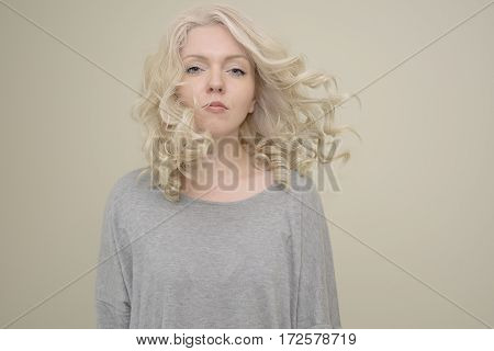 Portrait of a young beautiful girl with luxury hair flying