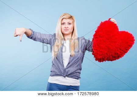 Woman Holding Red Heart Showing Thumb Down
