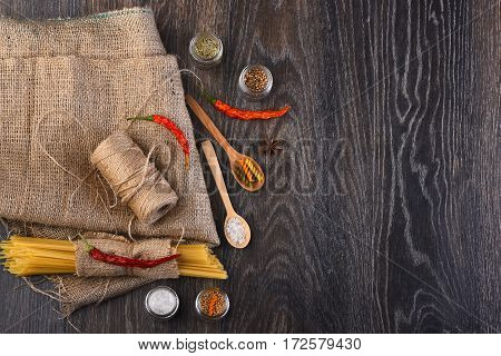 Bunch Of Spaghetti And String Bobbin On Sackcloth