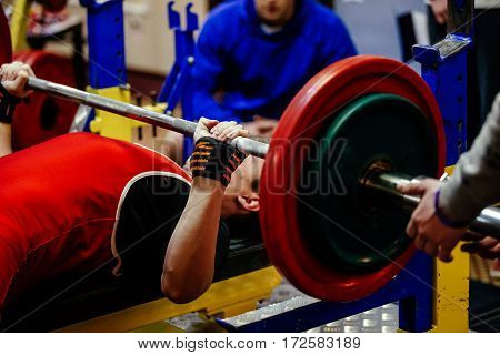 young male lifter bench press in powerlifting competitions