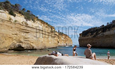 Victoria, Australia - October 2015: People sunbathing on the Loch Ard Gorge in Port Campbell National Park