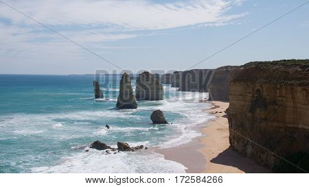 The Twelve Apostles is a collection of limestone stacks off the shore of the Port Campbell National Park, by the Great Ocean Road in Victoria, Australia.
