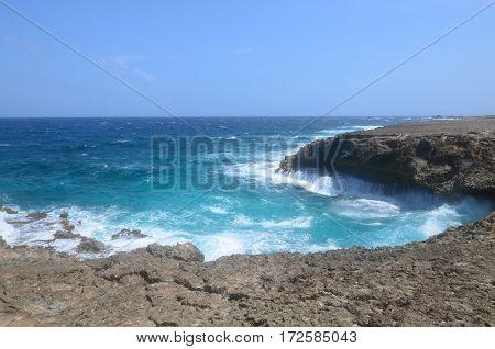 East coast of Aruba with waves crashing on Daimari beach.