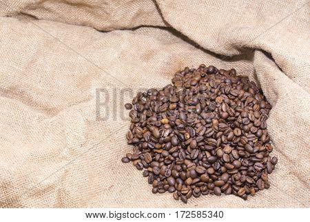arabica coffee beans in a burlap bag.