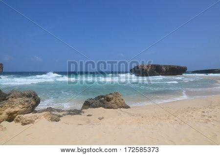 Moro or small Aruba rock formation on a secluded beach on the island.