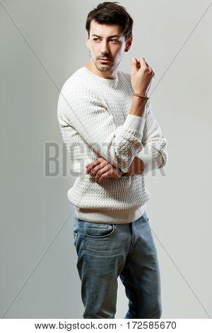 portrait of young handsome man posing in studio