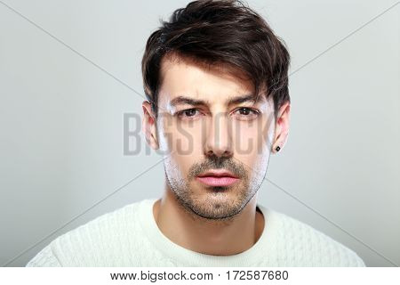 handsome young man face close up portrait look serious