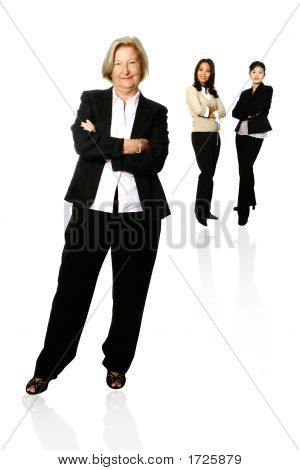 Caucasian Businesswoman Leading Two Colleagues
