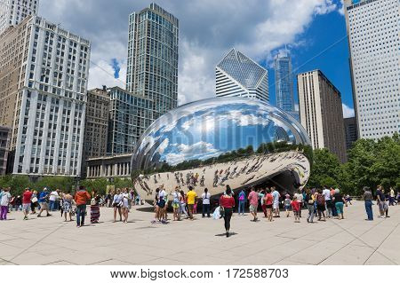 Chicago Illinois USA - July 3 2014: Tourist around the Cloud Gate (