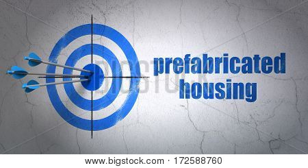 Success building construction concept: arrows hitting the center of target, Blue Prefabricated Housing on wall background, 3D rendering
