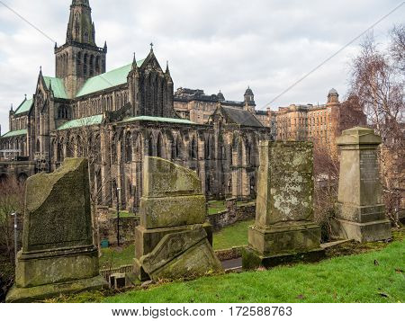 Tumbstones on Necropolis, the Victorian cemetery in Glasgow. Below lies Glasgow Cathedral, also named the High Kirk of Glasgow or St. Mungo's Cathedral